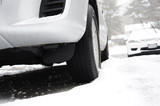 close up on tire of car with snow and ice - 172781463