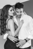 Fashion portrait of a beautiful sexy couple. Black and white image - 172792057