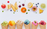 Various of ice cream flavor in cones blueberry ,strawberry ,pistachio ,almond ,orange and cherry setup on white wooden background . Summer and Sweet menu concept. - 172793251