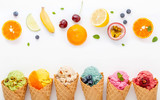 Various of ice cream flavor in cones blueberry ,strawberry ,pistachio ,almond ,orange and cherry setup on white wooden background . Summer and Sweet menu concept. - 172793478