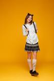 Full length portrait of a happy teenage schoolgirl in uniform - 172794825