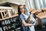 Portrait of young female student in library - 172797223