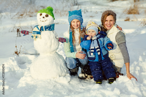 family with snowman Poster