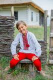 Little boy in Ukrainian embroidered shirt.