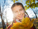 Beautiful young girl - colorful autumn portrait