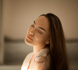 Woman closed eyes with pleasure and red lips smile or dream - 172813450