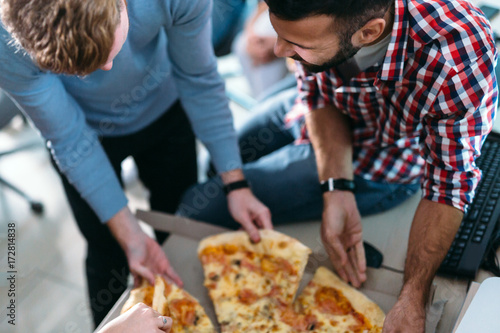 Software enginneers sharing pizza on break from work Poster