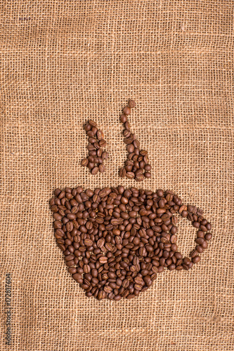 Papiers peints Café en grains Cup of coffee, coffee grain on fabric textured brown background