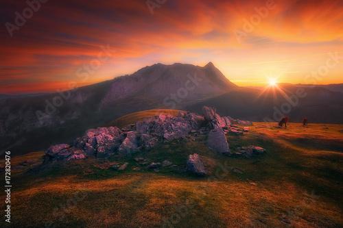 Fotobehang Bordeaux Anboto peak from Urkiolamendi mountain at red sunrise
