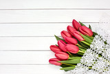 Bouquet of pink tulips on white wooden background. Top view, copy spaсe