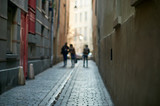 three young people on a narrow street in paris