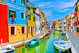 Fototapety View of the colorful Venetian houses along the canal at the Islands of Burano in Venice.