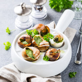 Bourgogne Escargot Snails with garlic herbs butter in white pan on light gray background. Healthy food concept. - 172834019