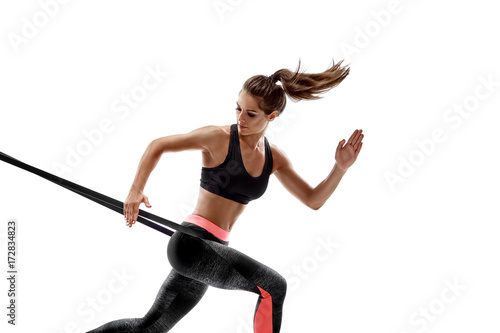 Sticker Woman exercising fitness resistance bands in studio silhouette isolated on white background