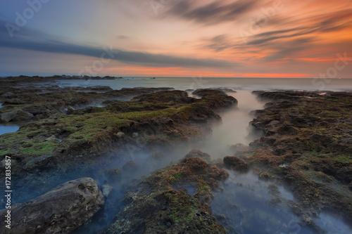 Foto op Plexiglas Zee zonsondergang Beautiful Tanjung Layar Beach, Sawarna during sunset in Banten, West Java Indonesia