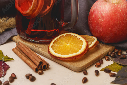 mulled wine with cinnamon. On a bright wooden background.