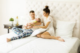 Young couple on the bed with baby girl - 172842225