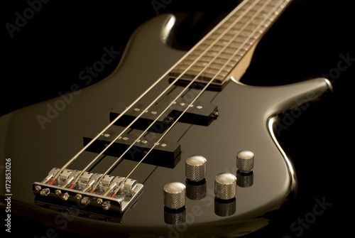Electric Bass Guitar on Black Background - 172853026