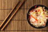 Glass noodles salad and chopsticks. Korean cuisine. Top view
