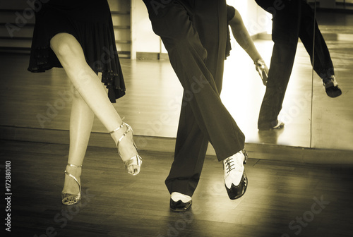 Male and female legs dancing latin rhythms and swing - 172881010