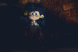 Possessed rag doll emerge form darkness of ancient sewer. Terror scene - 172889228