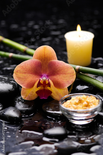 Keuken foto achterwand Spa spa concept –orange orchid with stones, candle and bamboo grove
