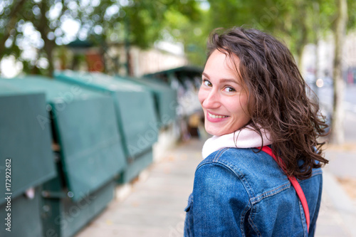 Fridge magnet Portrait of a young tourist woman on Paris dock next to Notre Dame - Tourism and travel concept