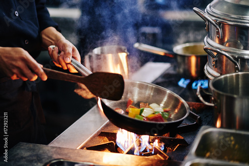 Poster Frying vegetables