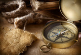 antique compass with rope and book on vintage paper background - 172930646