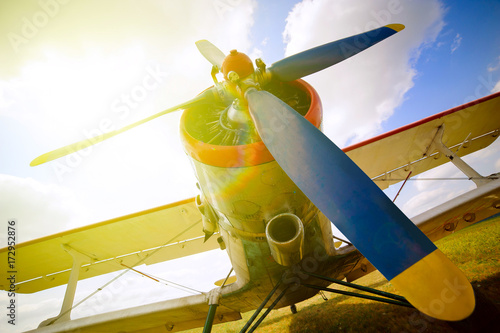Part of a old small blue and white plane on a background of blue sky Poster