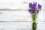 Fresh flowers of lavender bouquet, top view on white wooden background - 172977656