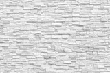 Surface white wall of stone wall gray tones for use as background. The new design of modern stone wall. pattern of decorative stone wall surface. © prapann