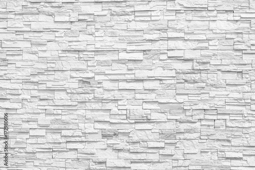 Surface white wall of stone wall gray tones for use as background. The new design of modern stone wall. pattern of decorative stone wall surface.