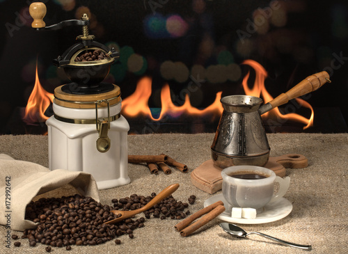 Papiers peints Café en grains freshly ground hot coffee with grains and cinnamon on the table