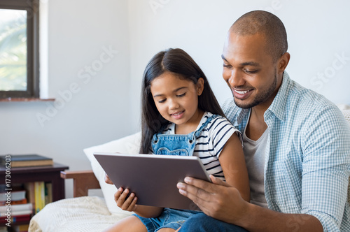 Father and daughter using tablet