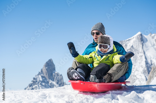 Father with son sledding