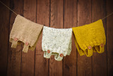 Warm hand knit baby clothes hanging on a clothesline - 173020662