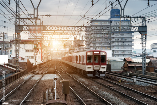 Japan train on railway with skyline at Osaka, Japan for transportation backgroun Poster