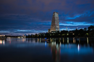 Basel switzerland in blue hour wit reflections in rhine river
