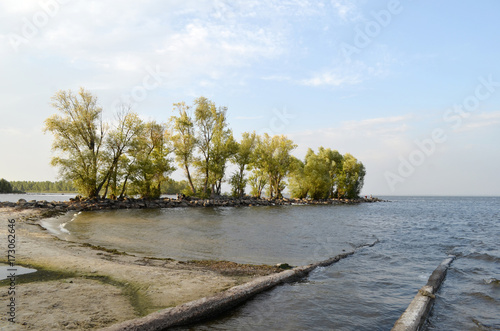 Plagát breakwater on river with a trees
