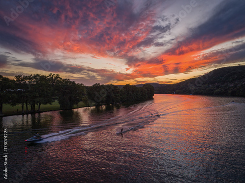 Deurstickers Aubergine Speeding boat and waterski on Lake Austin in Austin,Texas during sunset