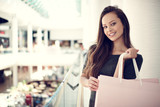 Beautiful woman with shopping bags in big mall. - 173080071