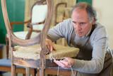 Man uplholstering chair - 173097401