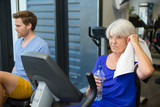 elderly woman on the exercise machine - 173097875