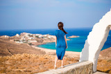 Young woman and traditional white church with sea view in Mykonos island,Greece - 173106404