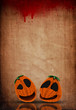 3D Halloween Jack o lanterns on a grunge blood splattered paper background