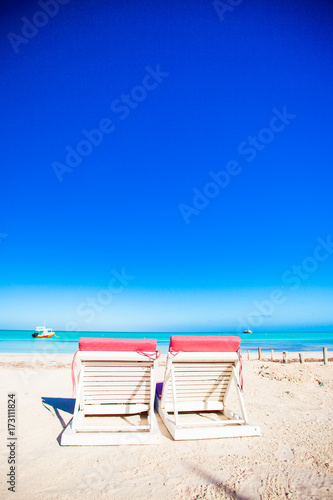 Foto op Aluminium Donkerblauw Beach sunbeds on white sand beach