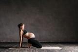 Young beautiful  pregnant yoga posing in studio - 173121812