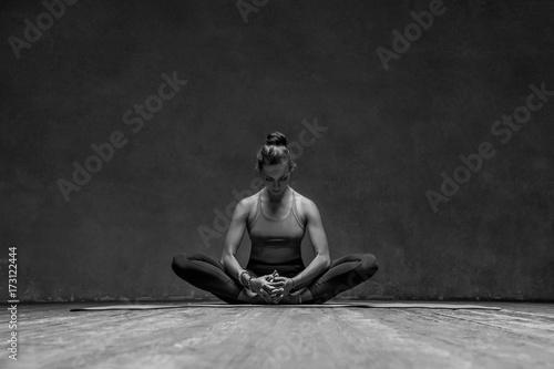 Plakat Young beautiful yoga female posing in studio