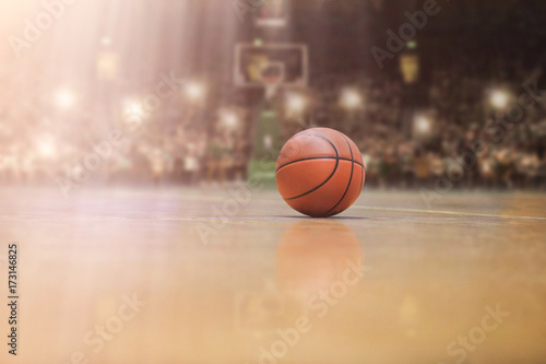 basketball ball in front of big modern basketball arena Poster